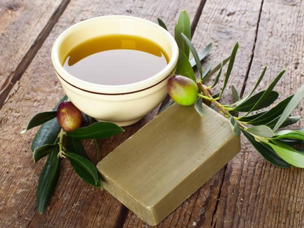 18256468 – aleppo soap and olives on wooden table